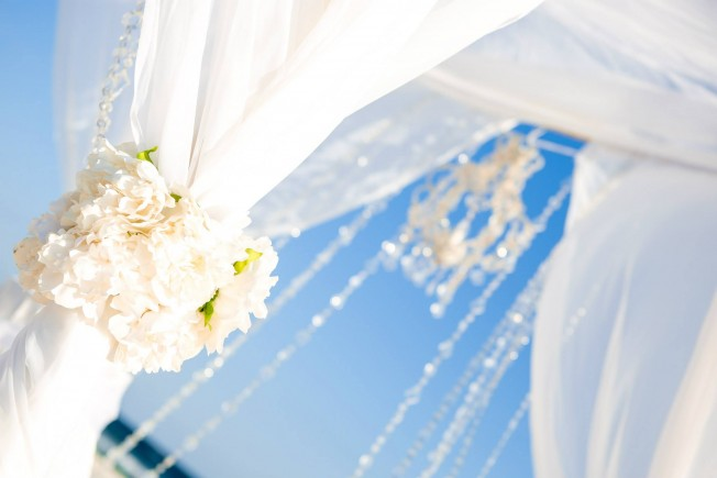 crystal chandelier on bamboo arbor, panama city beach florida beach wedding