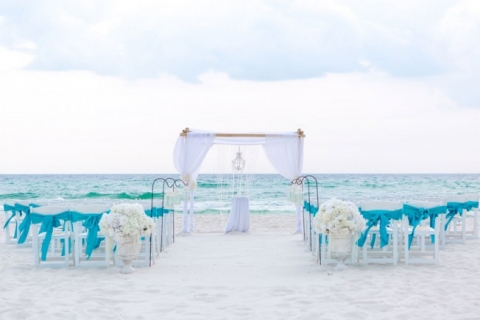 bamboo arbor with turquoise material beach wedding
