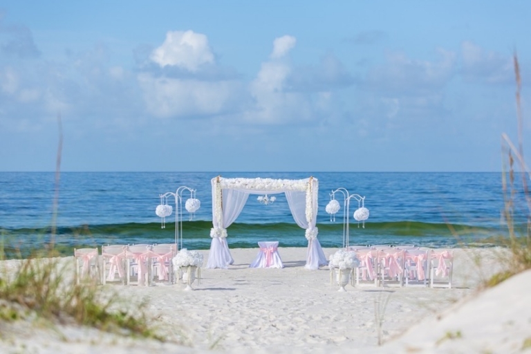 blush pink chair sashes beach wedding ceremony panama city beach florida
