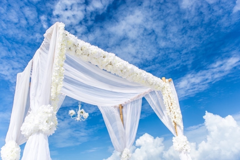 white lush flowers bamboo arbor florida beach wedding panama city