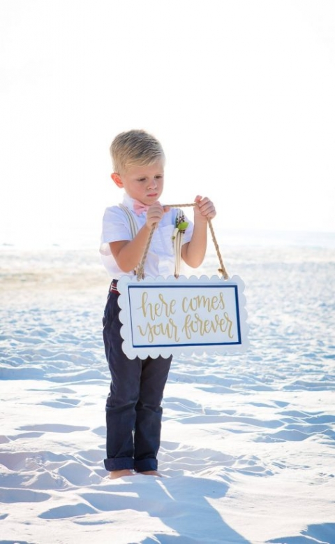 sign carrier outfit beach wedding