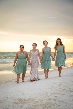 bridesmaids-sunset-beach-ceremony
