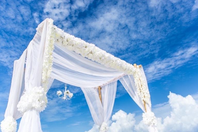 white lush flowers bamboo arbor florida beach wedding panama city